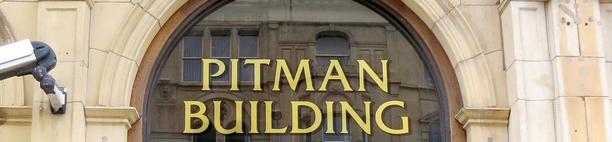 Pitman Building with buildings reflected