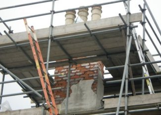 Repair works to a chimney. Was the defendant here liable for such works to his surrendered property?