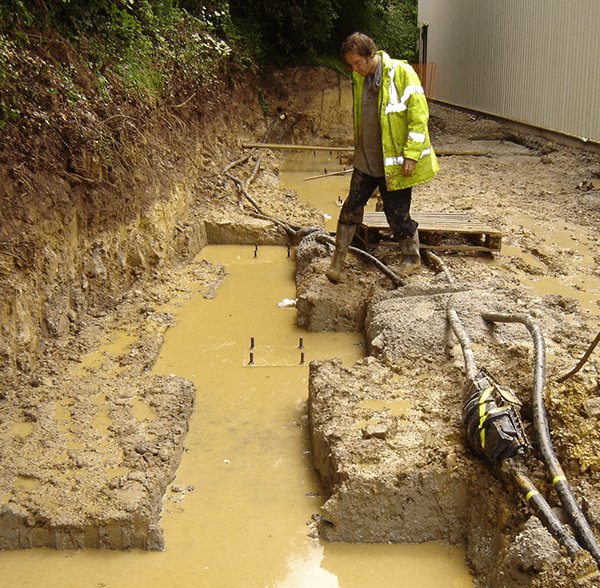 Drainage trench full of muddy water