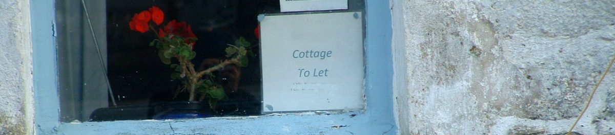 Cottage to let sign displayed in house window
