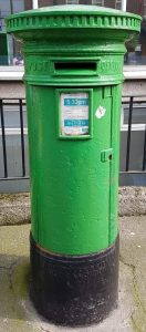 Emerald green Irish letterbox outside homes