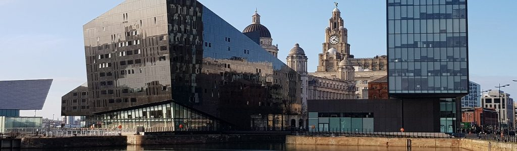 Modern buildings completed on Liverpool's waterfront with more traditional properties in the background