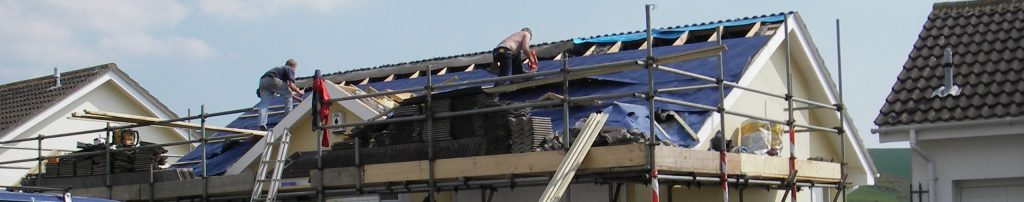 men working on house roof