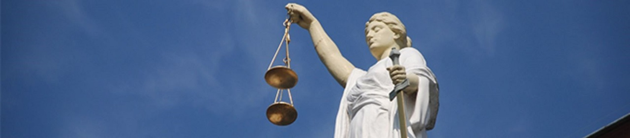Scales of justice above law courts